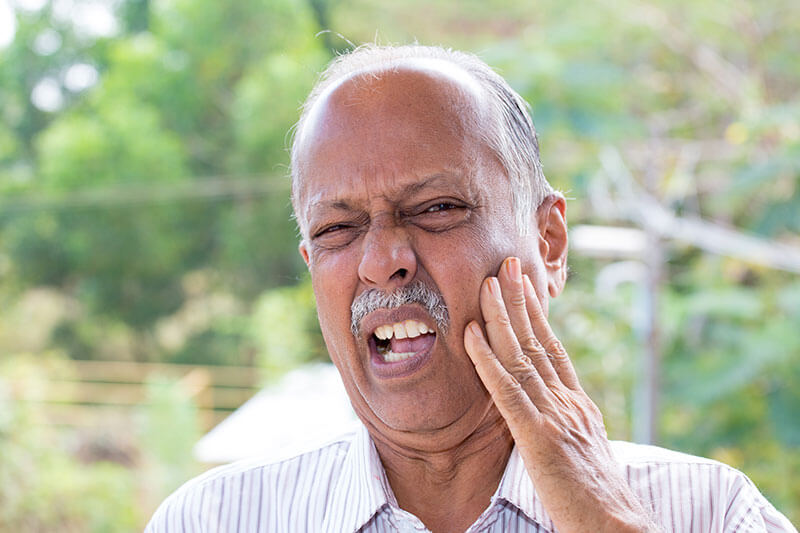 older man with toothache