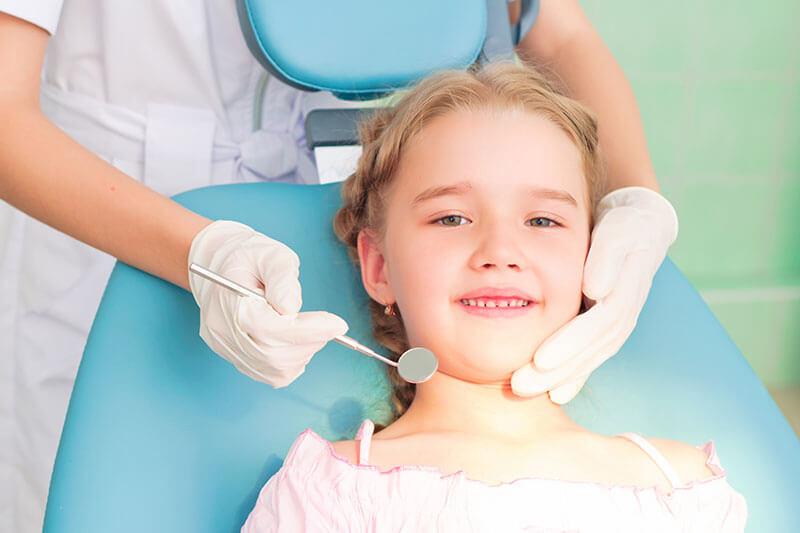 little girl smiling during her dental exam